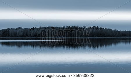 Serene Landscape. Sunset On The Lake, Calm Water Surface, Symmetrical Reflection
