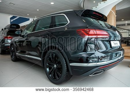Novosibirsk, Russia - March 09, 2020:  Black Expensive Volkswagen Touareg, Back View.  New Modern Cr
