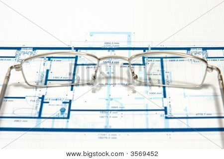 Blueprint For A House And Eyeglasses