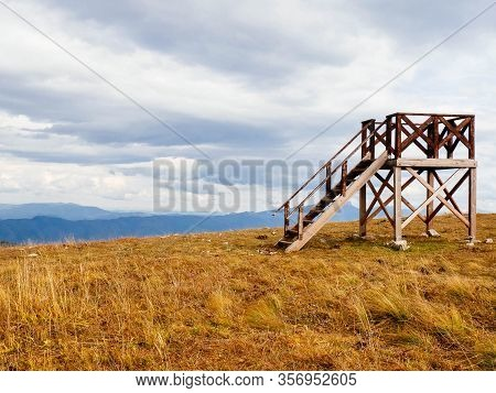Wooden Lookout Tower In The Mountains Copy Space. Observation Point For Forest Fires. The Concept Of
