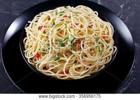 Close-up Of Pasta Aglio, Olio E Peperoncino, Italian Spaghetti With Garlic, Chili Pepper And Olive O