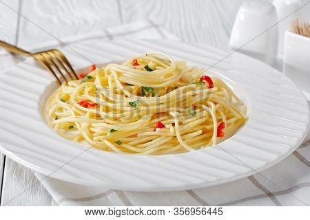 Pasta Aglio, Olio E Peperoncino, Italian Spaghetti With Garlic, Chili Pepper And Olive Oil On A Whit
