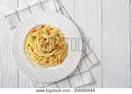 Pasta Aglio, Olio E Peperoncino, Italian Spaghetti With Garlic, Chili Pepper And Olive Oil On A Whit