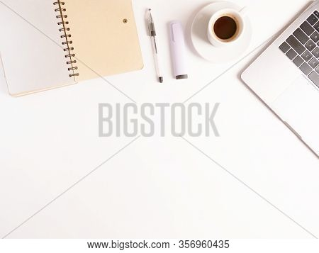 Flat Lay Composition With Laptop, Coffee, Pen And Notebook On White Desktop. Copyspace. Concept Remo