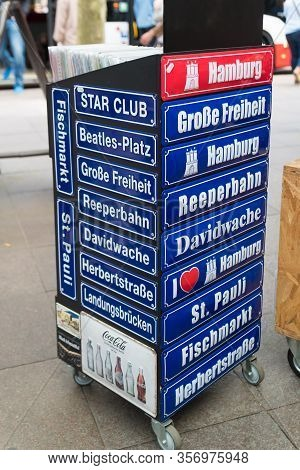 Hamburg, Germany - May 12, 2018: Souvenir Shields With Famous Hamburger Landmarks On It At A Souveni