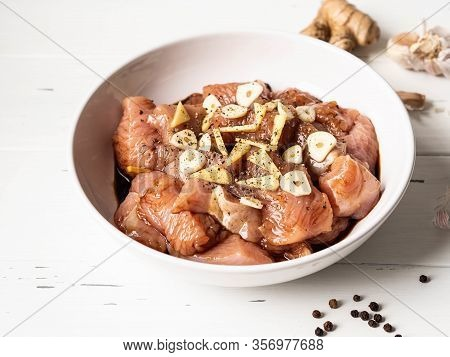 Raw Diet Marinated Turkey Meat With Garlic, Ginger And Teriyaki Sauce In A White Bowl. Marinating Me