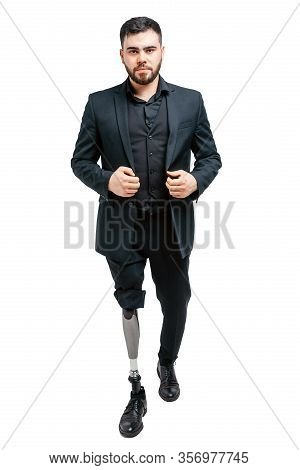 Disabled Young Man With Prosthetic Leg, Artificial Limb Concept. Standing In Studio Isolated Over Wh