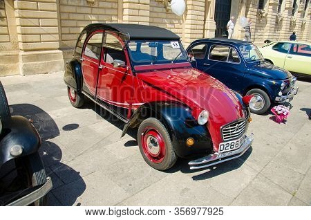 Lecce, Italy - April 23, 2016: Front View Of Vintage Classic Retro Red Automobile Car Parked In A St