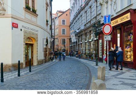 Prague, Czech Republic - January 21, 2019: Unknown Tourists Walk In Historic Center Of City (stare M