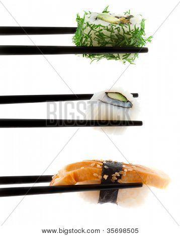 Sushi with chopsticks shot on white