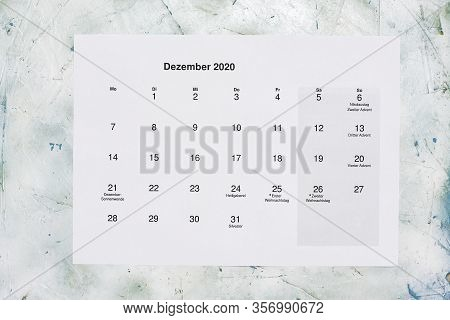 Monatskalender Dezember 2020. Translation: Monthly December 2020 Calendar. Paper December Month Cale