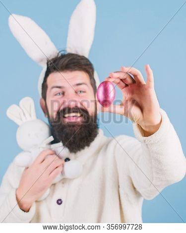 Easter Symbol Concept. My Precious. Bearded Man Wear Silly Bunny Ears. Hipster Cute Bunny Long Ears
