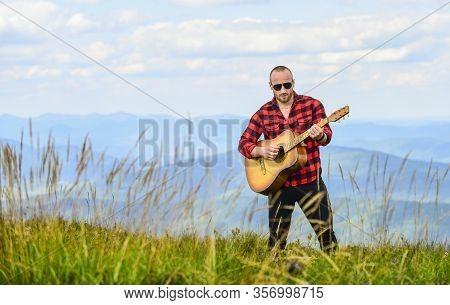 Keep Calm And Play Guitar. Man Hiker With Guitar On Top Of Mountain. Hiker Enjoy Nature. Musician Hi