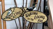 Pretty handcarved wooden signs welcoming people to homes and gardens in rural America. poster