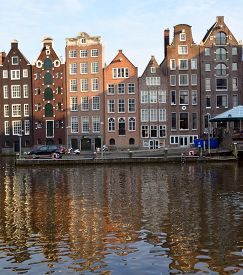 Amsterdam Netherlands October 03 2015: Typical Canal Houses . Canal Houses Usually Had A Basement An