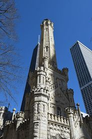 Looking Up At The Historic Old Water Tower Building, Chicago On Michigan Avenue  Under A Clear Blue