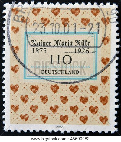 A stamp printed in Germany shows cower of book by Rainer Maria Rilke