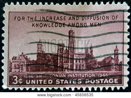 A stamp printed in the USA shows For the increase and diffusion of knowledge among men Smithsonian