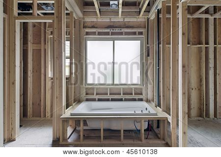 Installation of Soaking Bathtub in Master Bedroom Suite of New Home Construction poster