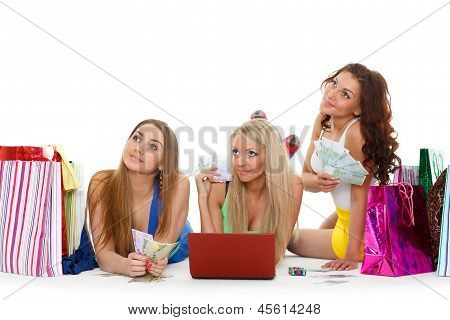 Three Young Women With  Laptop. Shopping.