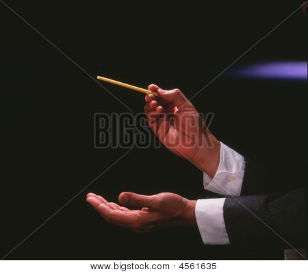 Music Conducter Conducting An Orchestra