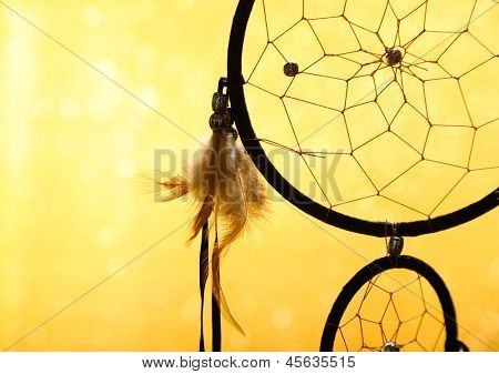 Beautiful dream catcher on yellow background