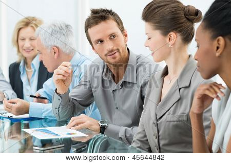 Group Of Coworkers Working In Conference Room