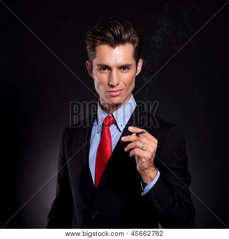 business man smokes cigarette