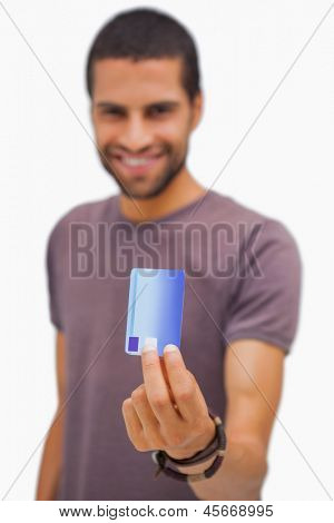 Smiling man holding credit card on white background