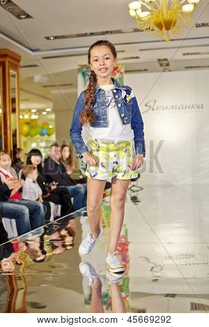 MOSCOW - MAR 17: Girl model performs teen sporty style at podium of Children Gallery Yakimanka during 5th Yakimanka Kids Fashion Week, March 17, 2012, Moscow, Russia.