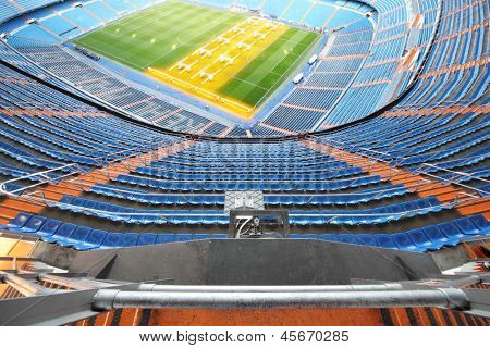 MADRID - MAR 8: Grandstand and artificial light for growing lawns in Santiago Bernabeu Stadium - arena of soccer club Real Madrid, Mar 8 2012 Madrid, Spain. ?lub Real Madrid created March 6, 1902.