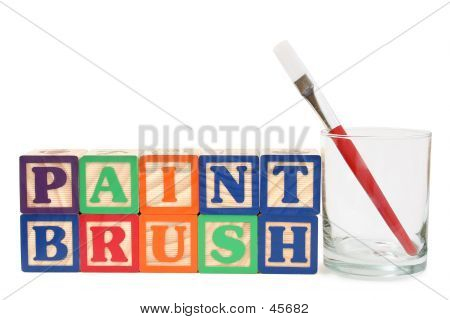 Alphabet Blocks And Paint Brush  In A Glass