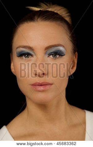 Beautiful Woman With Green Eyes And Blue Makeup