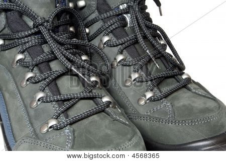 Lacing view on pair trekking boots - isolated on white poster