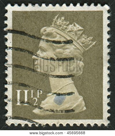 UK-CIRCA 1981: A stamp printed in UK shows image of Elizabeth II is the constitutional monarch of 16 sovereign states known as the Commonwealth realms, in Drab, circa 1981.