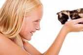 caring teen girl holding a little kitten isolated on white poster