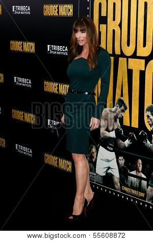 """NEW YORK-DEC 16: Model Jennifer Flavin attends the world premiere of """"Grudge Match"""" at the Ziegfeld Theatre on December 16, 2013 in New York City."""
