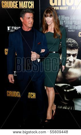 """NEW YORK-DEC 16: Actor Sylvester Stallone and wife Jennifer Flavin attend the world premiere of """"Grudge Match"""" at the Ziegfeld Theatre on December 16, 2013 in New York City."""