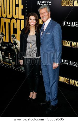 "NEW YORK-DEC 16: Announcer Michael Buffer and wife Christine Buffer attend the world premiere of ""Grudge Match"" at the Ziegfeld Theatre on December 16, 2013 in New York City."