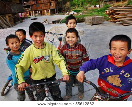 Funny Asian Children From Rural Areas Of China, Ride Bikes.