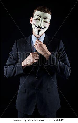 Man in suit wearing vendetta mask