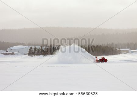 Snow Blower Clearing Road In Winter Storm Blizzard
