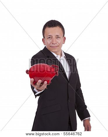 Handsome young businessman with a piggy bank