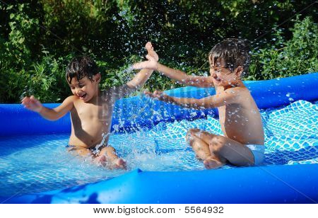 Children Activities On Swiming Pool In Summer