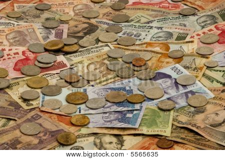 A pile of foreign currency including bills from India, Korea, Taiwan, US, Honduras, and Malaysia poster