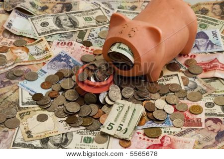 Foreign Currency And Piggy Bank