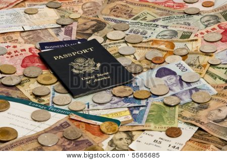 Passport With Foreign Money And Plane Tickets