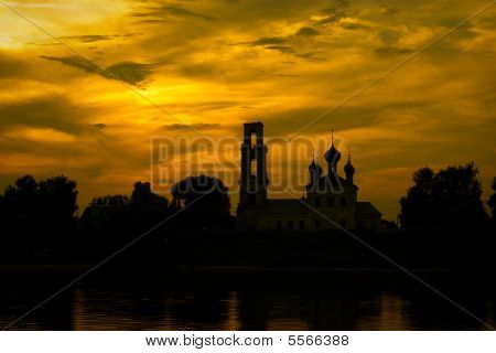 silhouette of bell tower and church on background sky