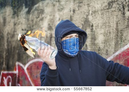 Man with Molotov cocktail at the hands of