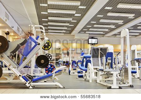 Fitness center with traineger equipments